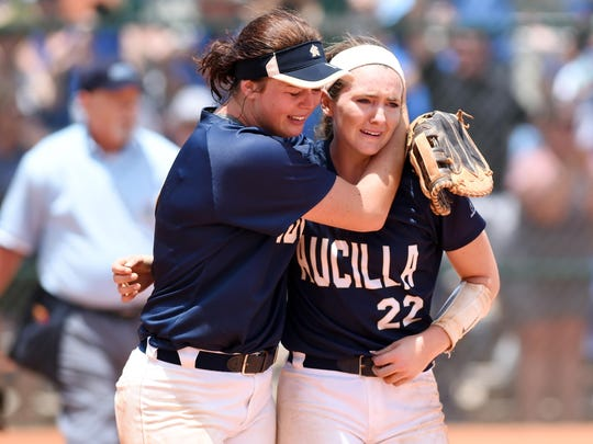 Aucilla Christian's Abigail Morgan (left) and Elizabeth Hightower console one another after a 2-1 loss in nine innings in the state title game to Canterbury during the FHSAA Class 2A state championship at Historic Dodgertown in Vero Beach, Thursday. May 18, 2017.