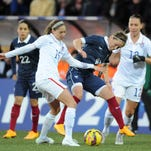 U.S. midfielder Morgan Brian, left, vies for the ball with France midfielder Camille Abily during the friendly on Sunday.