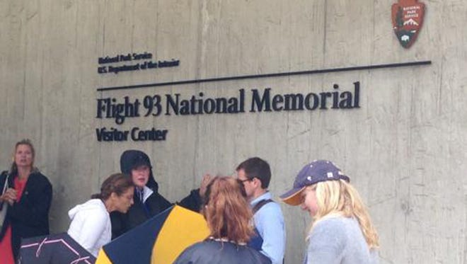 Visitors gather outside the Flight 93 National Memorial Visitor Center in Shanksville, Pa., on Thursday, Sept. 10, 2015. The visitor center was dedicated a day before the 14th anniversary of the Sept. 11, 2001, terror attacks.