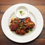 Korean chicken wings with blue cheese and carrot/celery  brunoise, as prepared by Chef Kelly Fletcher of the Revival, as seen in Tempe on Aug. 28, 2014