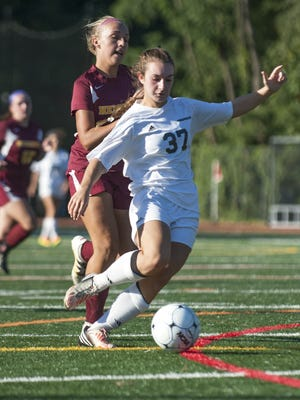 Haddonfield's Julia Parker, right, controls the ball in front of Haddon Heights' Anna Bailey a game played on Sept. 22