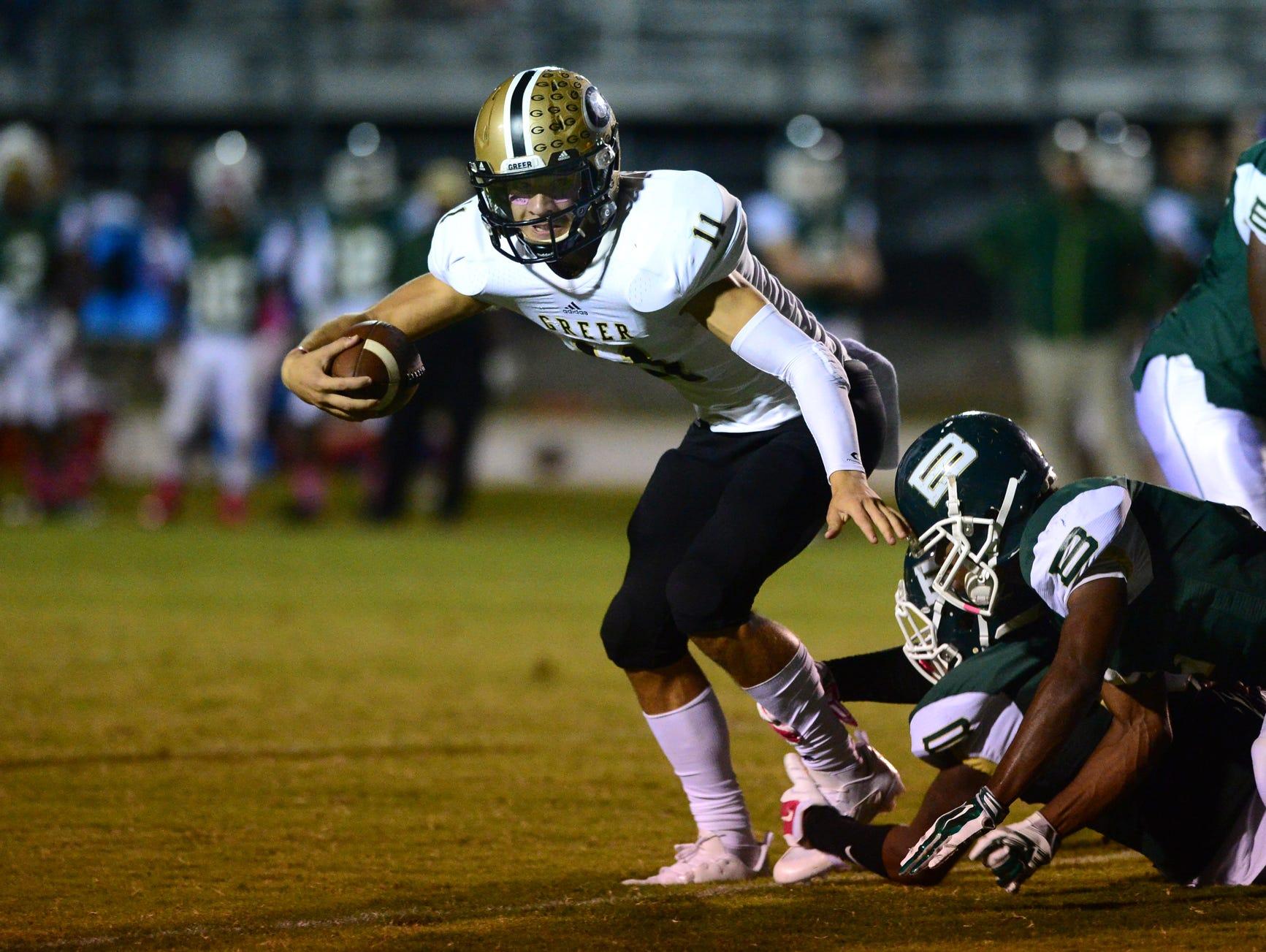 The Greer High's Mario Cusano (11) runs past Berea defense during a football game at Berea on Friday, October 9, 2015.