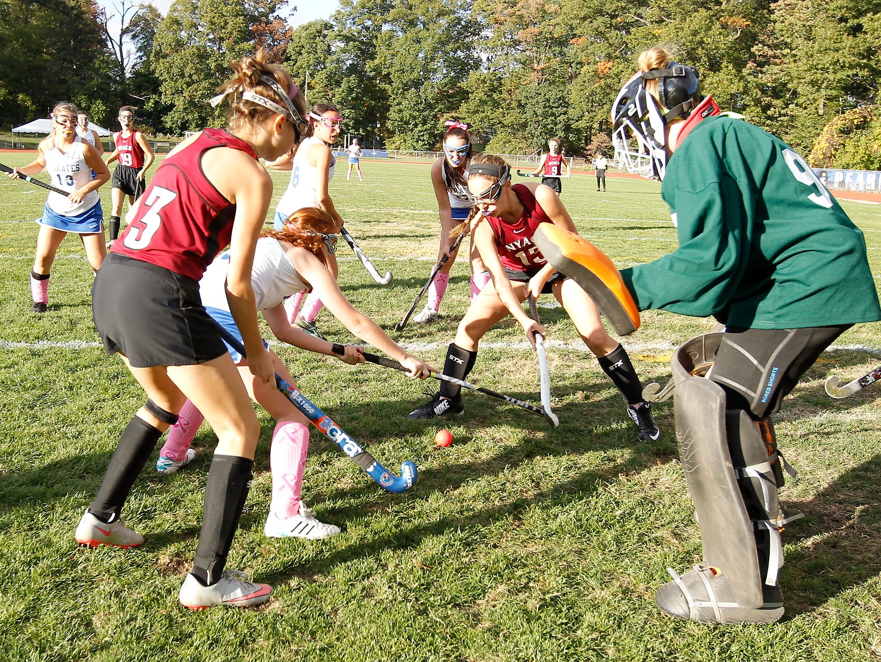 Nyack goalie Calieigh Travers (95) right, awaits a shot during a varsity field hockey game at Pearl River High School on Friday, Oct. 16, 2015.