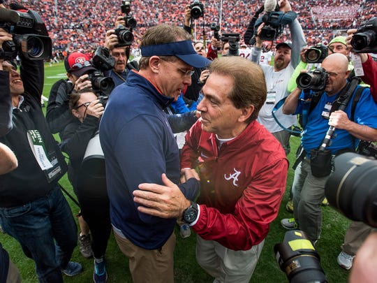 Auburn head coach Gus Malzahn and Alabama head coach Nick Saban greet at midfield before the Iron Bowl in Auburn, Ala. on Saturday November 25, 2017. (Mickey Welsh / Montgomery Advertiser)