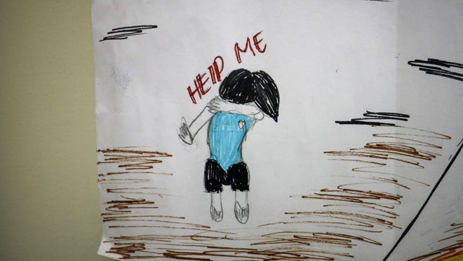 This drawing, created by young sex trafficking survivors in a shelter in the Philippines, hangs in Sister Gabriella BottaniÕs office in Rome,  Italy.  Bottani leads the Catholic anti-trafficking organization Talitha Kum, a network of 1,500 nuns around the world.
