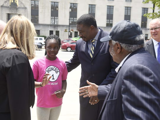Mayor Megan Barry, left, talks with Ava Joseph, 10, and Metro Nashville Public Schools Superintendent Shawn Joseph and Rev. James Thomas of the Jefferson Street Missionary Baptist Church before a prayer vigil in front of Metro police department's headquarters July 8, 2016 in Nashville, Tenn. Sgt. Rob Forrest is in the back on the right.
