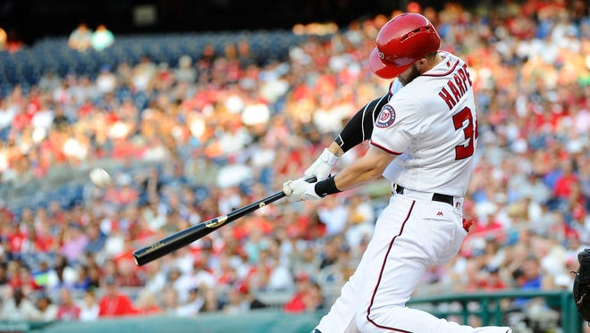 Washington Nationals right fielder Bryce Harper (34) hits a two run home run against the Los Angeles Dodgers during the first inning at Nationals Park.