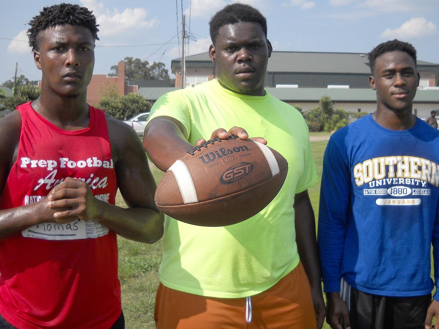 Ville Platte High's Traylon Thomas, Vondarius Freeman and Terez Alfred take a break from the afternoon heat earlier this week during conditioning drills at the Bulldogs' football field. The three Bulldogs' team leaders are expected to help VPHS gain a playoff berth this season in District 5-3A. .
