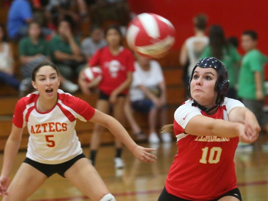 Palm Desert's Courtney Calhoun (10) returns the ball during the Aztecs' DVL opener against Palm Springs on Tuesday. Palm Springs won 3-0. See more photos at desertsun.com.