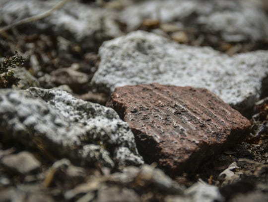 A fragment of textured pottery, estimated to have been