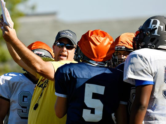 Dallastown head coach Kevin Myers (left) is seen here