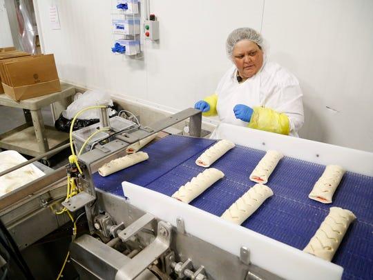 Kathy DeWolf keeps an eye on the frozen Butter Braid