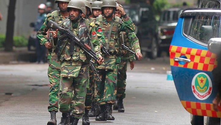 Bangladesh police clear out an area to facilitate action