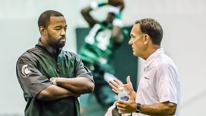 Curtis Blackwell, MSU's director of college advancement and performance, is a key strategist for Mark Dantonio, right, and the Spartans' recruiting efforts.