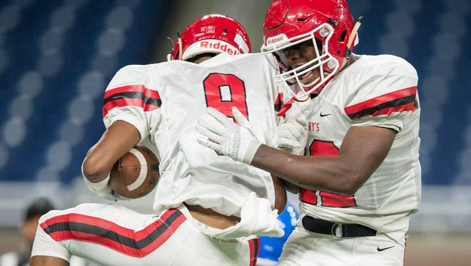 St. Mary's wide receiver Josh Walls (9) and RaShawn Allen face Muskegon in the Division 3 final on Saturday at Ford Field.