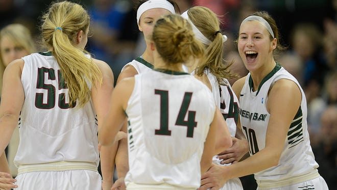 UW-Green Bay's Mehryn Kraker (10) is all smiles as he celebrates with her teammates against Western Michigan during Saturday's game at the Kress Center in Green Bay. Evan Siegle/Press-Gazette Media