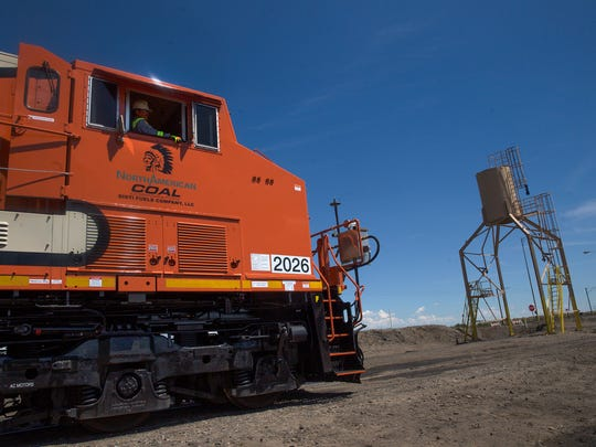 A new locomotive is unveiled Wednesday during a ceremony at the Navajo Mine North Facility south of Farmington.