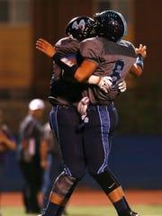 Chapin running back Matthew Zubiate, left, and quarterback Matthew Castillo celebrate a second quarter touchdown.