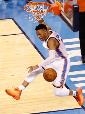 Russell Westbrook jams home two of his 30 points Sunday night. He also had 12 assists.