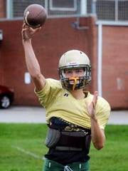 York Catholic quarterback Wes Burns throws during practice