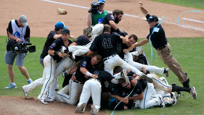 FILE - In this June 30, 2016, file photo, Coastal Carolina players celebrate their 4-3 victory over Arizona to win the championship after Game 3 of the NCAA College World Series baseball finals in Omaha, Neb. Coming off its surprise national championship in its first appearance at the College World Series, Coastal Carolina enters 2017 with a mostly new lineup but the same high expectations. (AP Photo/Nati Harnik, file)
