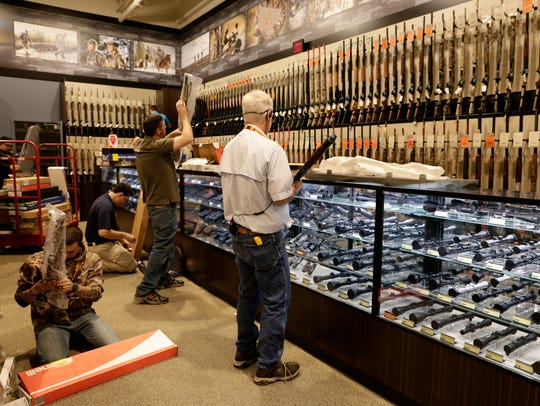 Employees stock guns at DICK'S Sporting Goods and Field and Stream stores in Lafayette, Louisiana, in 2016.