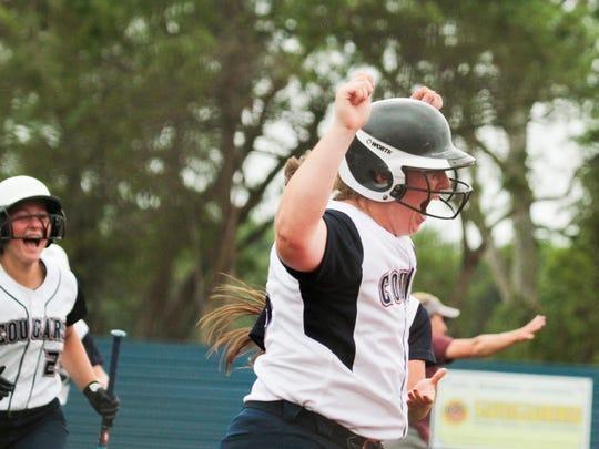 St. Thomas More's Bailey Hemphill celebrates a teammate's home run in the fifth inning of Monday's 9-0 win over South Terrebonne.