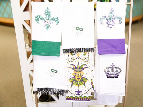 Mardi Gras themed towels on sale at Caroline and Company