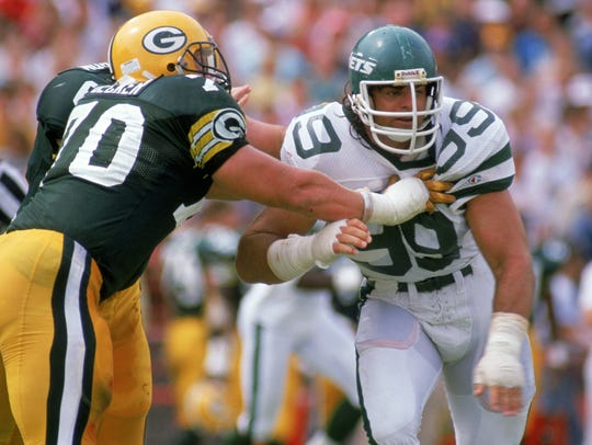 Defensive end Mark Gastineau #99 of the New York Jets