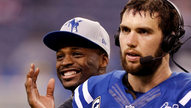 Reggie Wayne, left, stood behind Andrew Luck and the Colts in Saturday's comeback victory.