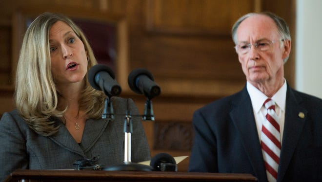 Alabama Medicaid Commissioner Stephanie Azar and Governor Robert Bentley discuss the budget impact to Alabama Medicaid Agency at the State Capitol Building in Montgomery, Ala. on Wednesday April 6, 2016.