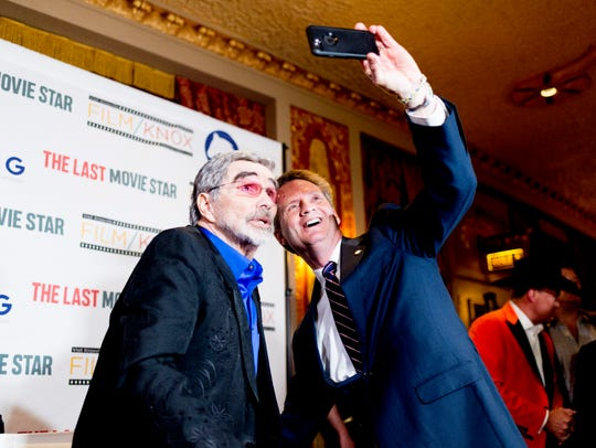 "Knox County Mayor TIm Burchett takes a selfie with Burt Reynolds during a red carpet movie premiere for ""The Last Movie Star"" at the Tennessee Theatre in Knoxville, Tennessee on Thursday, March 29, 2018."