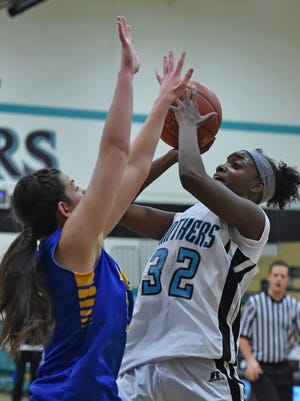 North Valleys' Passion Burrell shoots with Reed's Tori Baer covering her during Tuesday's game at North Valleys