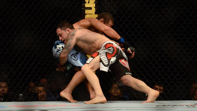Frankie Edgar fights against Urijah Faber at UFC Fight Night in Manila, Philippines.