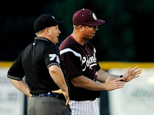 Nathan Isenberg, right, was dismissed as Henderson County's baseball coach on Wednesday.