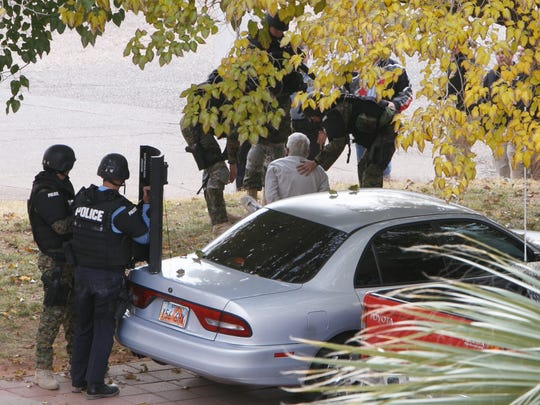 St. George Police officers take Guy Roy Fotheringham into custody after a nearly 10-hour armed standoff with the SWAT team Dec. 2, 2014.