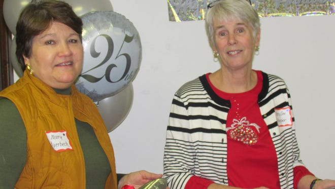 Mary Lee Scheper and Mary Averbeck were each awarded a commemorative trowel to honor their 25 years of service.