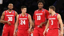 Wisconsin seniors Vitto Brown (from left), Bronson