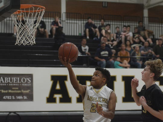 Abilene High's Jordan Booker goes up for a layup during the Eagles' 58-55 loss to Keller in both teams' District 3-6A opener Thursday at Eagle Gym.