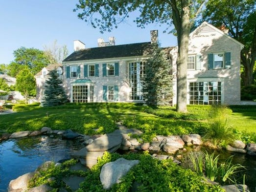 This six-bedroom, seven-bath, 11,176-square-foot home