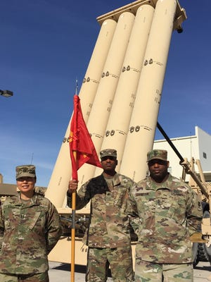 From left, Capt. Mison Kang, Staff Sgt. Anwar Newton and 1st Sgt. Cedric Covington of Delta Battery, 2nd Air Defense Artillery Regiment (THAAD) stand before a launcher at Fort Bliss.