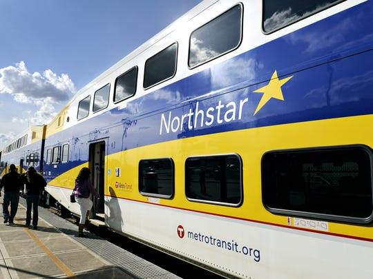 Passengers board a Northstar train at the Big Lake station.