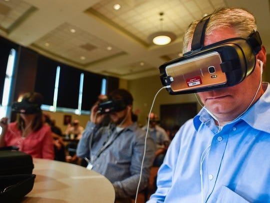 Attendees to the Simulated Workplace presentation held in Maynard Hall at OSU Marion try out a workplace simulation programed on virtual reality goggles on Wednesday.