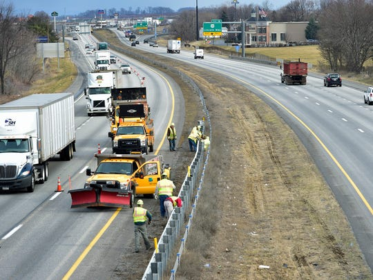 PennDOT workers are installing guard rails in the median