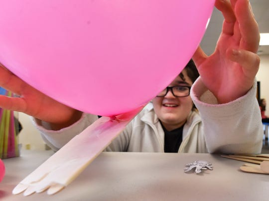 Anna Edges' flight of her Crew Exploration Vehicle (CEV) is aided by a balloon  at the Boys & Girls Club of Door County Wednesday, April 5, 2017.