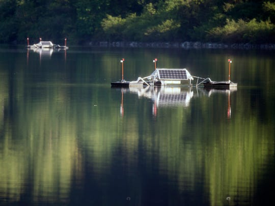 Two of five SolarBees are shown on Lake Redman. By