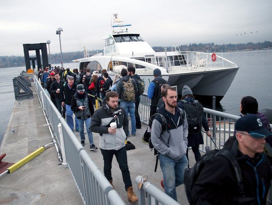 Commuters from Seattle exit the Kitsap Transit fast