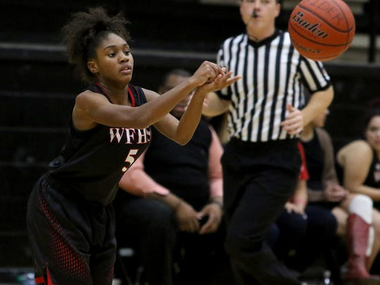 Wichita Falls High School's Dearne Singleton passes in the game against Rider Tuesday, Dec. 12, 2017, at Rider.