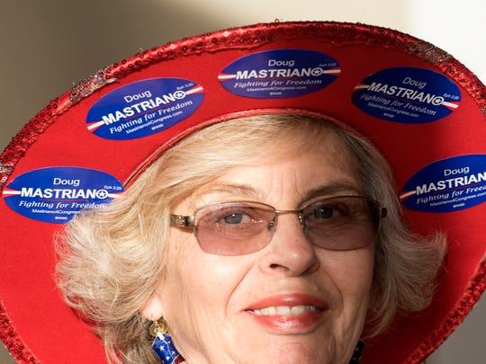 Carol Wagaman wears her support for 13th Congressional District candidate Doug Mastriano, Thursday, April 26, 2018 at a Green Grove Garden event.