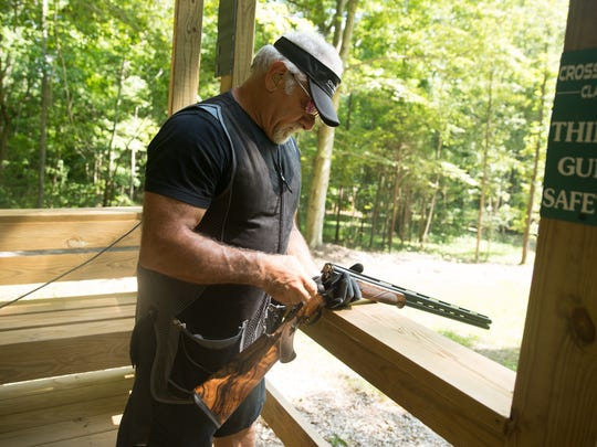 Cross Creek Clays owner Joseph Calabrace reloads his shotgun at his sport shooting facility in Palmyra, Tenn.